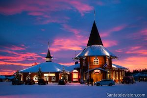Christmas house in Santa Claus Village and a red sunset