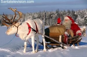Santa Claus having a reindeer ride in Lapland after Christmas