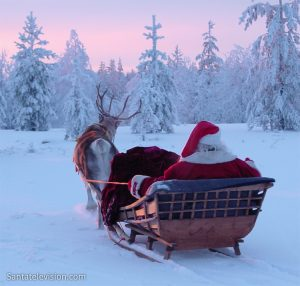 Santa Claus sleigh ride with reindeer in Lapland in Finland