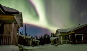 Northern Lights over the Valkea Arctic holiday village in Pello in Lapland, Finland