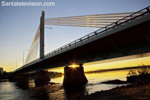 Sunset under the Lumberjack's Candle Bridge in Rovaniemi city center in Lapland