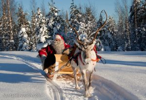 Santa Claus alias Father Christmas and his reindeer in Lapland, Finland