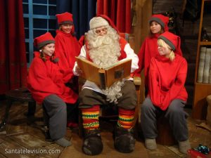 Santa Claus and the elves in Santa Claus Office in Rovaniemi, Finland