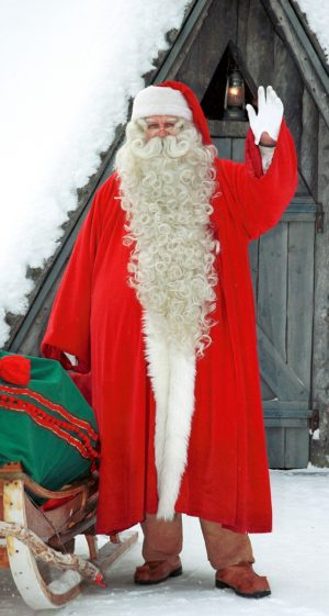 Santa Claus in Lapland greeting before his World Tour of Christmas night